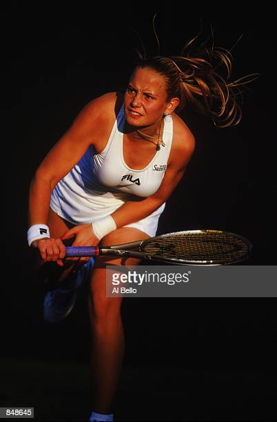 Jelena Dokic of Yugoslavia serves during the first round of the Lawn Tennis Championships at the All England Club in Wimbledon England on June 24 2002