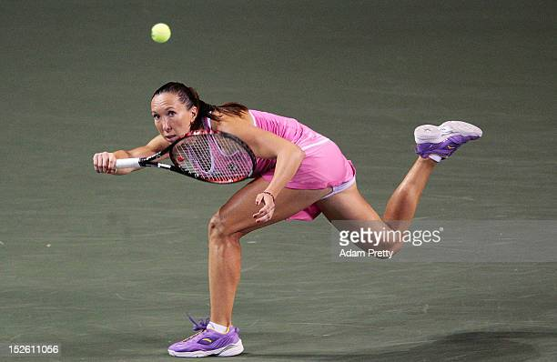 Jelena Jancovic of Serbia reaches for a forehand during her first round match against Yanina Wickmayer of Belgium during day one of the Toray Pan...
