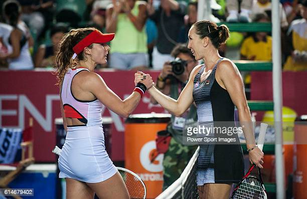 Jelena Janikovic of Serbia and Alize Cornet of France shake hands after their Singles Quarter Finals match at the WTA Prudential Hong Kong Tennis...