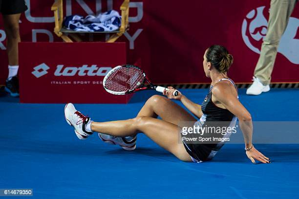 Jelena Janikovic of Serbia slips during her Singles Quarter Finals match against Alize Cornet of France at the WTA Prudential Hong Kong Tennis Open...