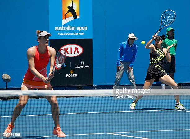 Jelena Jankovic of Serbia and Andrea Petkovic of Germany compete in their first round match against Raluca Olaru of Romania and Ysaline Bonaventure...