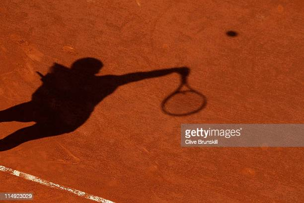 Jelena Jankovic of Serbia casts a shadow as she serves during the women's singles round four match between Jelena Jankovic of Serbia and Francesca...