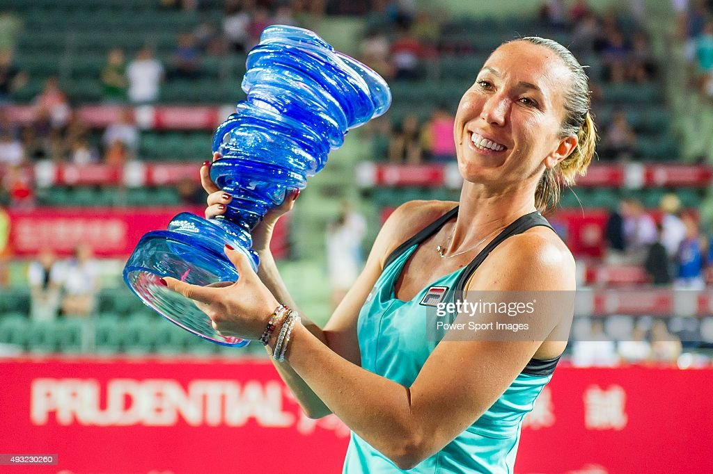 Jelena Jankovic of Serbia celebrates with the trophy after winning her match against Angelique Kerber of Germany during the WTA Prudential Hong Kong Open at the Victoria Park stadium on October 18, 2015 in Hong Kong, Hong Kong.