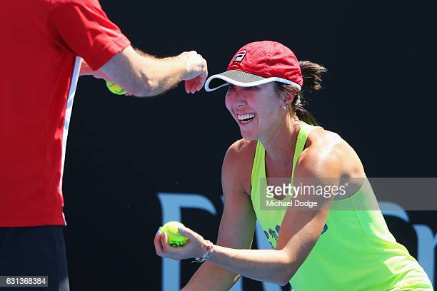Jelena Jankovic of Serbia enjoys a reflex drill of catching a dropped ball as part of a reflex drill with her coach during a practice session ahead...