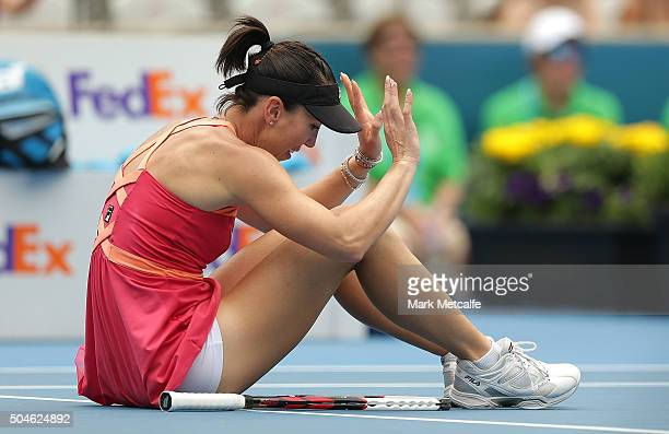 Jelena Jankovic of Serbia falls to the ground during a point in her match against Sara Errani of Italy during day three of the 2016 Sydney...