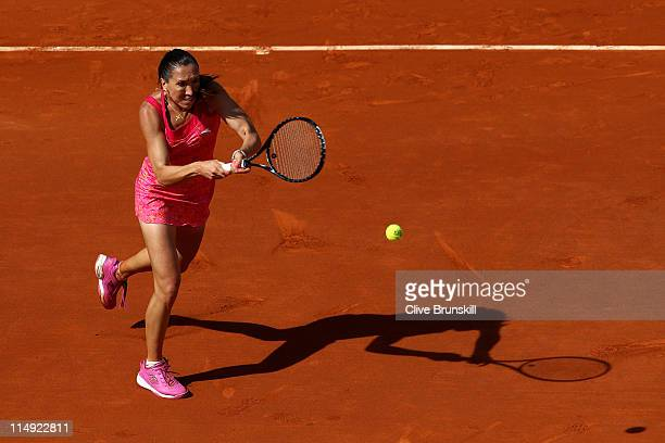 Jelena Jankovic of Serbia hits a backhand during the women's singles round four match between Jelena Jankovic of Serbia and Francesca Schiavone of...