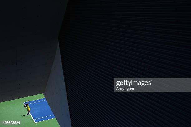Jelena Jankovic of Serbia hits a serve during the match against Serena Williams on Day 7 of the Western Southern Open on August 15 2014 at the Linder...