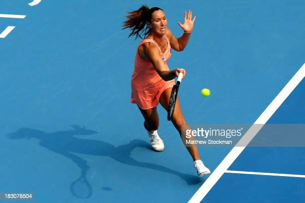 Jelena Jankovic of Serbia lunges for a shot while playing Lucie Safarova of Czech Republic during day seven of the 2013 China Open at the National...