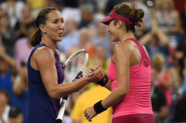 Jelena Jankovic of Serbia meets Belinda Bencic of Switzerland at the net after their US Open 2014 women's singles match at the USTA Billie Jean King...