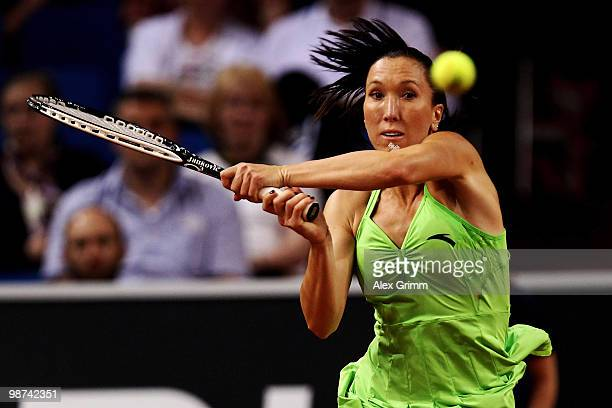 Jelena Jankovic of Serbia plays a backhand during her second round match against Tsvetana Pironkova of Bulgaria at day four of the WTA Porsche Tennis...