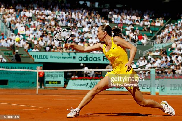 Jelena Jankovic of Serbia plays a backhand during the women's singles semi final match between Jelena Jankovic of Serbia and Samantha Stosur of...