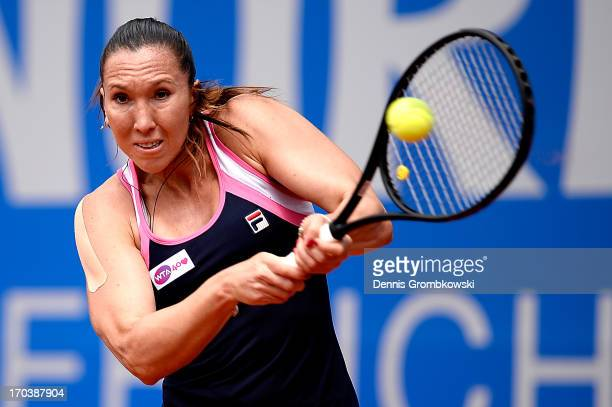 Jelena Jankovic of Serbia plays a backhand in her first round match against Arantxa Rus of Netherlands during day five of the Nuernberger Insurance...
