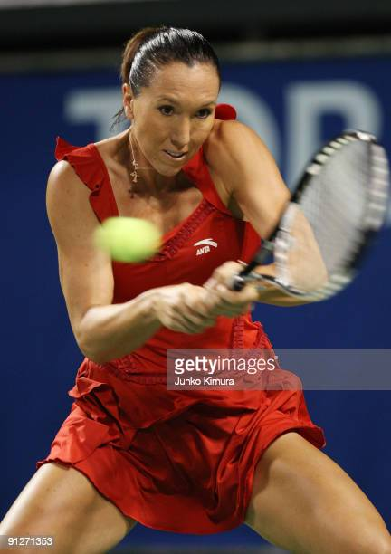 Jelena Jankovic of Serbia plays a backhand in her match against Elena Vesnina of Russia during day four of the Toray Pan Pacific Open Tennis...