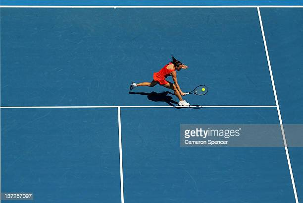 Jelena Jankovic of Serbia plays a backhand in her second round match against KaiChen Chang of Chinese Taipei during day three of the 2012 Australian...