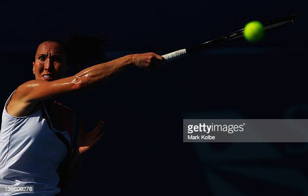 Jelena Jankovic of Serbia plays a forehand during her first round match against Julia Goerges of Germany during day two of the 2012 Sydney...
