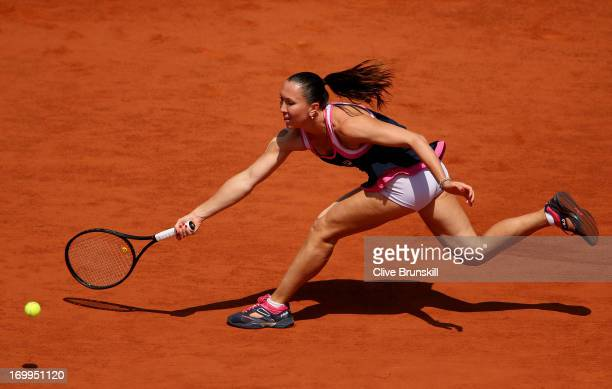 Jelena Jankovic of Serbia plays a forehand during her Women's Singles quarter final match against Maria Sharapova of Russia on day eleven of the...