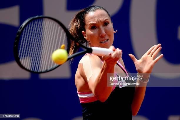 Jelena Jankovic of Serbia plays a forehand in her first round match against Arantxa Rus of Netherlands during day five of the Nuernberger Insurance...
