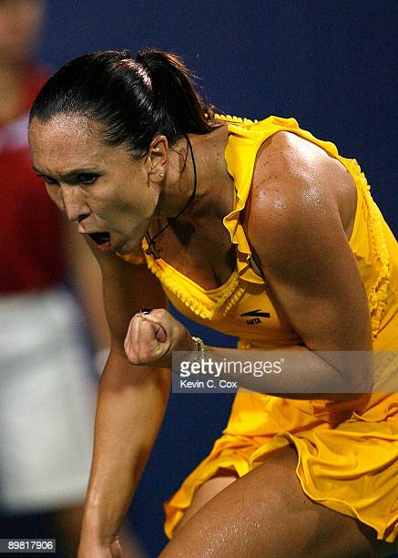 Jelena Jankovic of Serbia reacts after winning a point against Elena Dementieva of Russia during the semifinals of the Western Southern Financial...