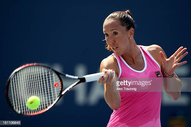 Jelena Jankovic of Serbia returns a shot against Agnieszka Radwanska of Poland during their women's singles third round match on Day Six of the 2012...