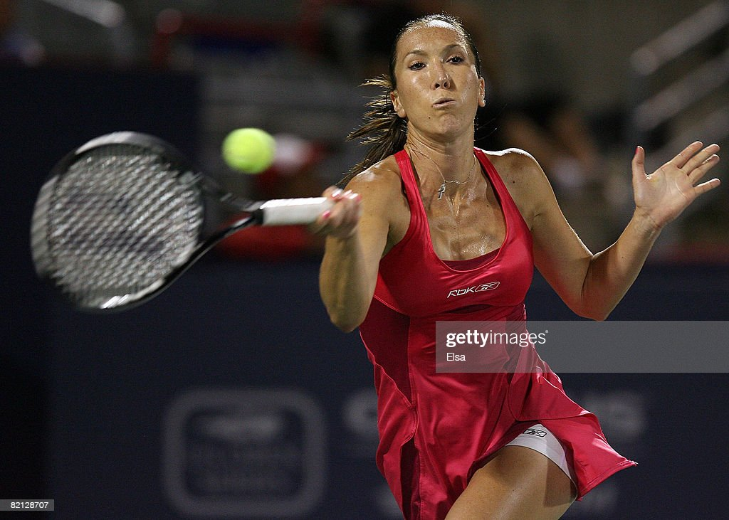 Jelena Jankovic of Serbia returns a shot against Aleksandra Wozniak of Canada during Day 3 of Rogers Cup Tennis on July 30,2008 at Stade Uniprix in Montreal, Quebec, Canada. Jankovic defeated Wozniak 6-0, 6-4.