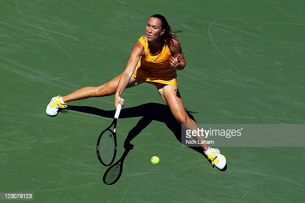 Jelena Jankovic of Serbia returns a shot against Alison Riske of the United States during Day Two of the 2011 US Open at the USTA Billie Jean King...
