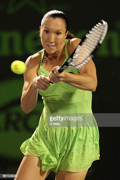 Jelena Jankovic of Serbia returns a shot against Elena Vesnina of Russia during day six of the 2010 Sony Ericsson Open at Crandon Park Tennis Center...
