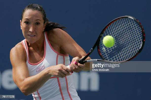 Jelena Jankovic of Serbia returns a shot against Justine Henin of Belgium during the Rogers Cup at the Rexall Center August 19 2007 in Toronto...