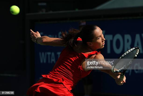 Jelena Jankovic of Serbia returns a shot against Marion Bartoli of France during day five of the Toray Pan Pacific Open Tennis tournament at Ariake...