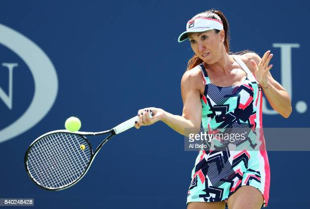 Jelena Jankovic of Serbia returns a shot during her first round Women's Singles match against Petra Kvitova of the Czech Republic on Day One of the...