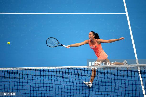 Jelena Jankovic of Serbia returns a shot during her women's semi-final match against Petra Kvitova of Czech Republic on day eight of the 2013 China...