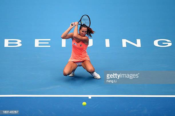 Jelena Jankovic of Serbia returns a shot during her women's semifinal match against Petra Kvitova of Czech Republic on day eight of the 2013 China...