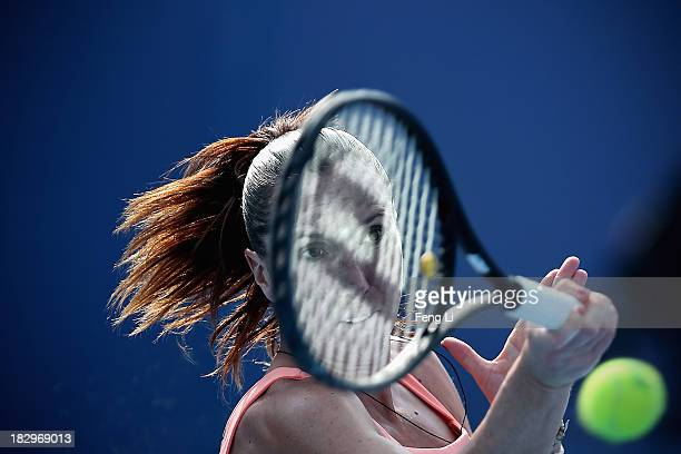 Jelena Jankovic of Serbia returns a shot during her women's singles match against Carla Suarez Navarro of Spain on day six of the 2013 China Open at...