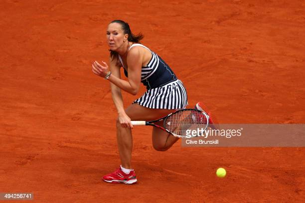 Jelena Jankovic of Serbia returns a shot during her women's singles match against Kurumi Nara of Japan on day five of the French Open at Roland...