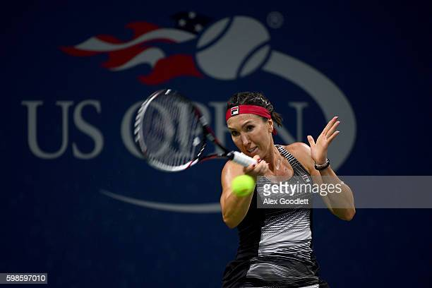Jelena Jankovic of Serbia returns a shot to Carla Suarez Navarro of Spain during her second round Women's Singles match on Day Four of the 2016 US...