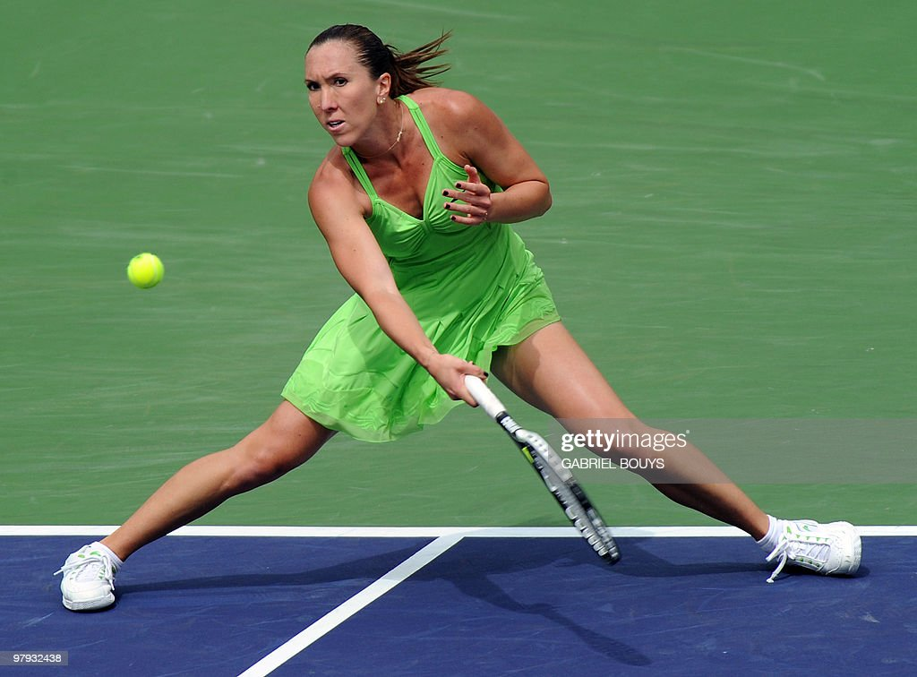 Jelena Jankovic of Serbia returns a shot to Caroline Wozniacki of Denmark during the final of the BNP Paribas Open on March 21, 2010 at the Indian Wells Tennis Garden in Indian Wells, California. Jankovic won 6-2, 6-4.