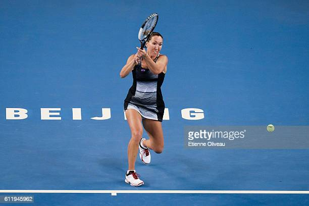 Jelena Jankovic of Serbia returns a shot to Kristina Mladenovic of France during the Women's singles first round on day two of the 2016 China Open at...