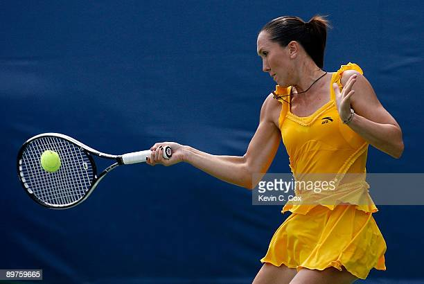Jelena Jankovic of Serbia returns a shot to Maria Kirilenko of Russia during Day 3 of the Western Southern Financial Group Women's Open on August 12...