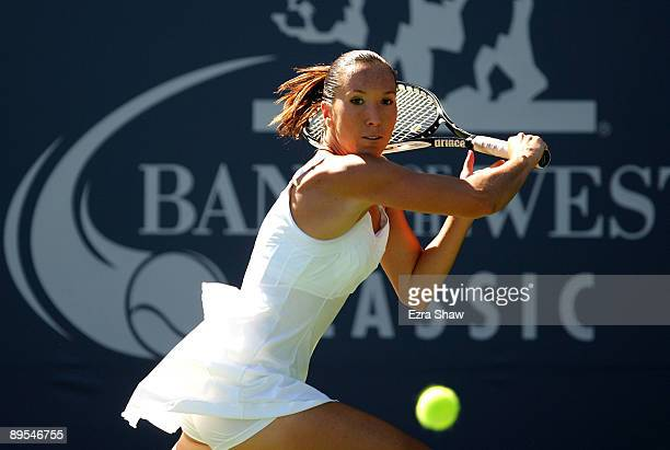 Jelena Jankovic of Serbia returns a shot to Marion Bartoli of France during their quarterfinal match on Day 5 of the Bank of the West Classic July...