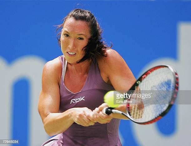 Jelena Jankovic of Serbia returns a shot to Martina Hingis of Switzerland on day two of the 2007 Medibank International at the Sydney International...