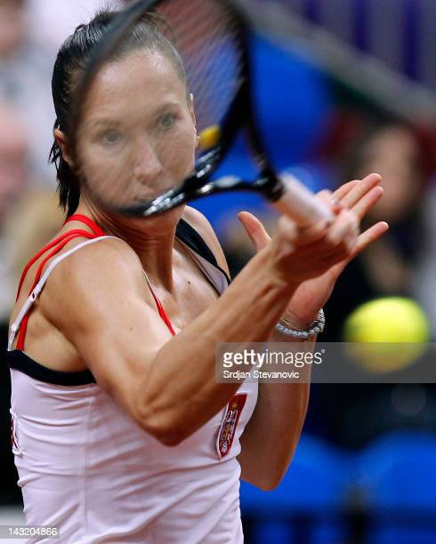 Jelena Jankovic of Serbia returns the ball during her single match against Anastasia Pavlyuchenkova of Russia during the Day One Semifinal Match in...