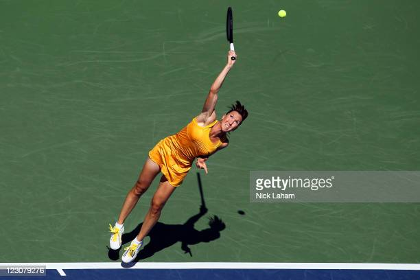 Jelena Jankovic of Serbia serves against Alison Riske of the United States during Day Two of the 2011 US Open at the USTA Billie Jean King National...