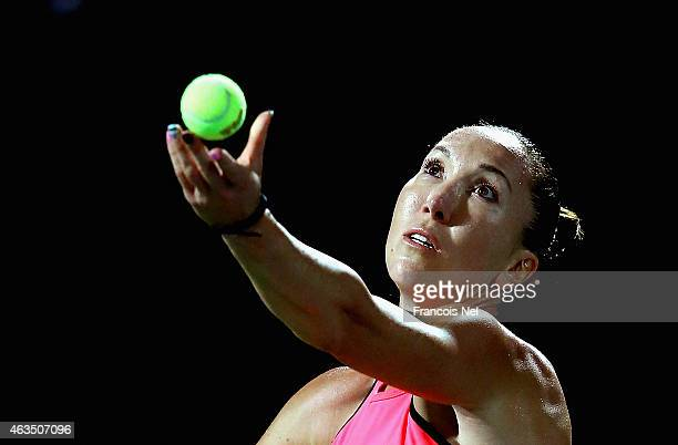 Jelena Jankovic of Serbia serves against Timea Babos of Hungary during day one of the WTA Dubai Duty Free Tennis Championship at the Dubai Duty Free...
