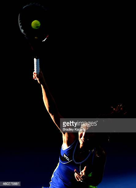 Jelena Jankovic of Serbia serves in her match against Victoria Azarenka of Belarus during day six of the 2014 Brisbane International at Queensland...