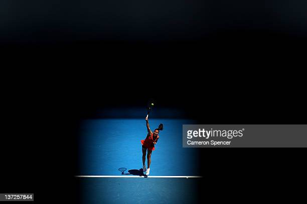 Jelena Jankovic of Serbia serves in her second round match against KaiChen Chang of Chinese Taipei during day three of the 2012 Australian Open at...