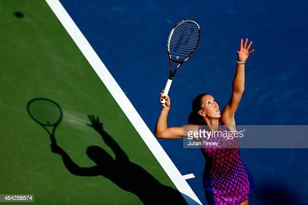 Jelena Jankovic of Serbia serves to Tsvetana Pironkova of Bulgaria on Day Three of the 2014 US Open at the USTA Billie Jean King National Tennis...