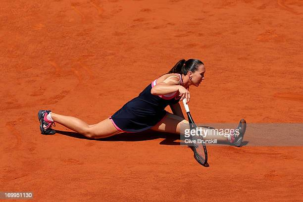 Jelena Jankovic of Serbia slips after stretching to play a forehand during her Women's Singles quarter final match against Maria Sharapova of Russia...