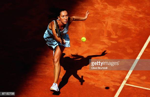 Jelena Jankovic of Serbia stretches for a forehand against Daniela Hantuchova of Slovakia in their second round match during the Madrid Open tennis...