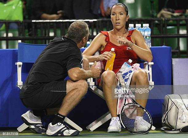 Jelena Jankovic of Serbia talks to her coach in her match against Na Li of China during day six of the Toray Pan Pacific Open Tennis tournament at...