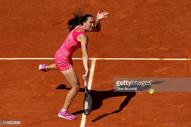 Jelena Jankovic of Serbia volleys during the women's singles round four match between Jelena Jankovic of Serbia and Francesca Schiavone of Italy on...