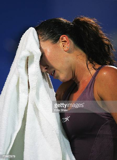 Jelena Jankovic of Serbia wipes her forehead after losing a point during her match against Kim Clijsters in the women's singles final on day six of...